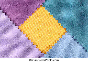 Composition of colored pieces of serrated cotton fabric.