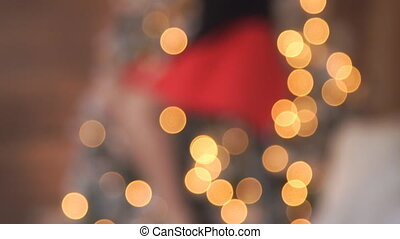 New Year's Eve, the girl the Christmas tree and fireplace on which the lighted candles, woman celebrating
