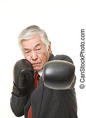 senior Japanese businessman throwing a left jab - senior...
