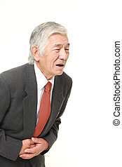 senior Japanese businessman suffers from stomachache -...