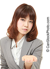 angry young Japanese businesswoman requests something -...