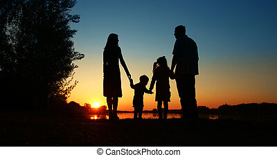 silhouette of a happy family