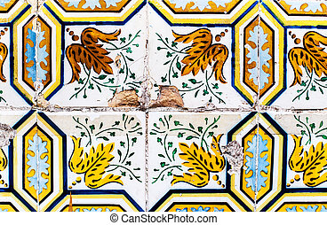 Detail of the traditional tiles azulejos from facade of old house in Lisbon, Portugal / Abstract colorful wall background.