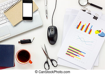 Top view accessories office desk concept.mobile phone,coffee,notepaper,pen,laptop,eyeglasses,chart on white office desk.