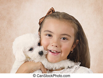 Pretty little girl with Bichon Frise puppy - Portrait of...
