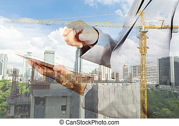 Double exposure of business engineer and abstract city -...
