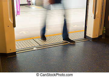 Motion Blur of People enter Train or Subway - People Enter...