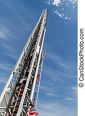 Sliding fire escape - Sliding fire ladder against cloudy,...