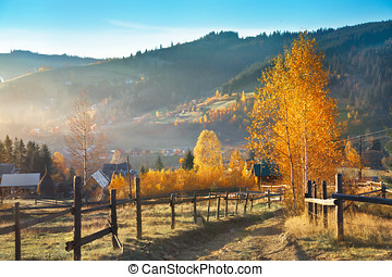 Mountain rural landscape with footpath in the autumn.