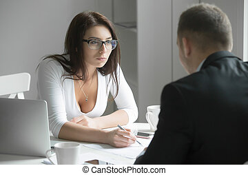 Businesswoman pointing to a mistake in a paper