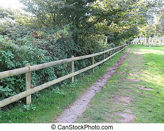 Countryside fence and narrow path in Dorset, UK