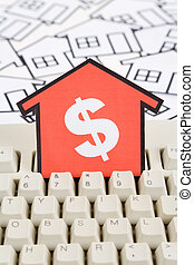 Real Estate Concept - a red home sign and computer keyboard,...
