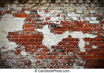 Grunge red brick wall texture with remaining plaster stucco...