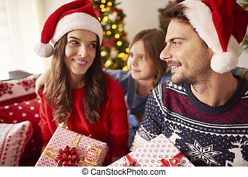 Family celebrating Christmas together at home