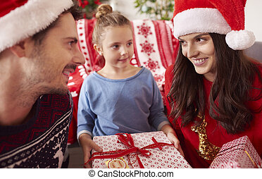 Happy family at Christmas with presents