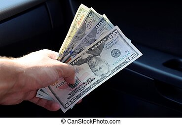 Hand transmitter dollars. Transferring money out of the hands. American dollars in a hand