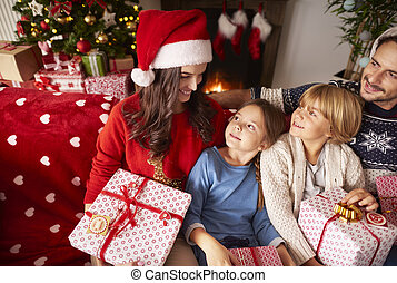 Family spending Christmas together at home