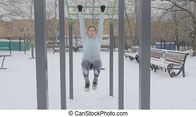 Fitness Workout Outdoors Winter - Young girl doing push-ups...