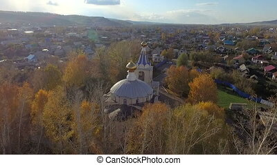 Aerial shot of church in little town in Russia. - Aerial...