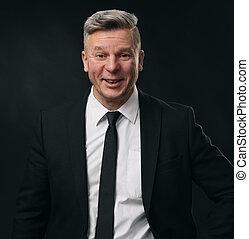 portrait of a confident mature businessman smiling. Black...