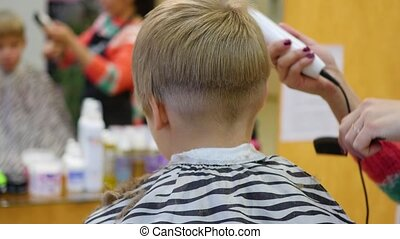 child's haircut at the Barber shop