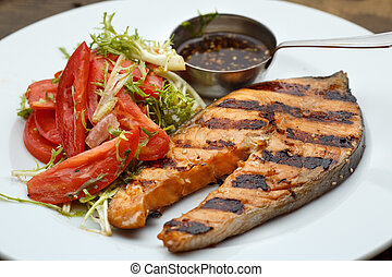 Grilled fish with and salad fresh tomatoes herbs