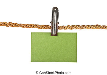 green paper on a rope isolated on white background closeup