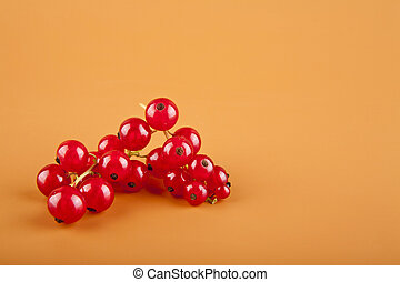 red currants on brown background