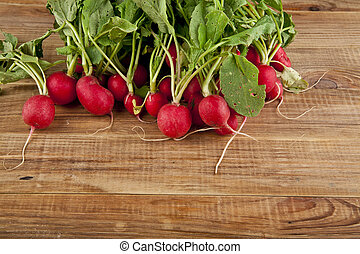 radishes on wooden background
