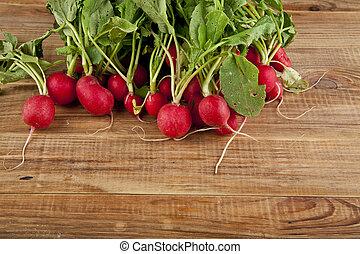 radishes on wooden background