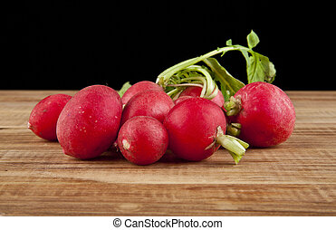 radishes on a black background