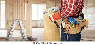 Builder with hammer and wooden planks. - Builder handyman...