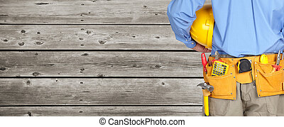 Construction worker with a tool belt. - Construction worker...