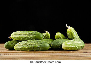 cucumbers on a black background closeup