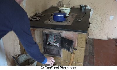 hand put wood old stove