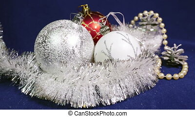 New Year's balls and ribbon on a blue background,