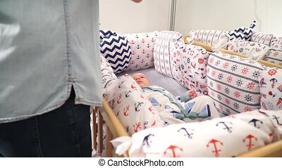 Baby lying in his crib