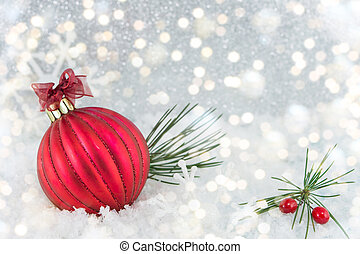 Christmas ball on shiny silver background