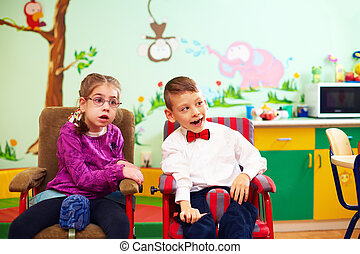 cute kids in wheelchairs at kindergarten for children with...
