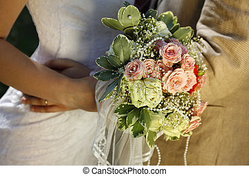 Newly married pair with bouquet