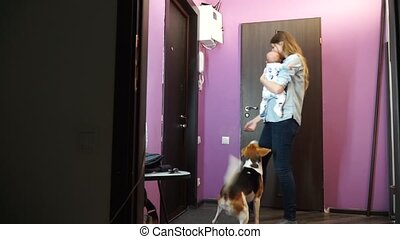 His wife and child and dog meet her husband from work