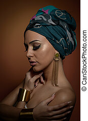 Beautiful woman with turban. Young attractive female with...