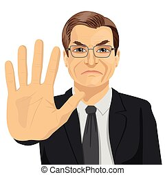 angry mature businessman with glasses showing stop gesture...