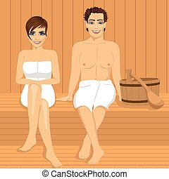 happy couple relaxing together in wooden sauna - happy...