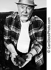 wealth of the earth - Black-and-white portrait of an elderly...