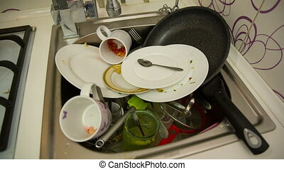 Dirty dishes in the sink - huge heap of dirty dishes