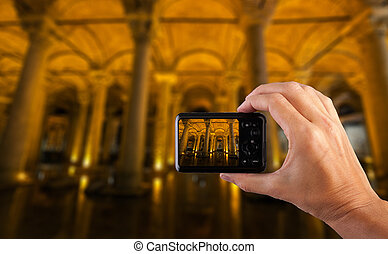 Travel concept. Hand making photo of city with camera. Istanbul. Turkey