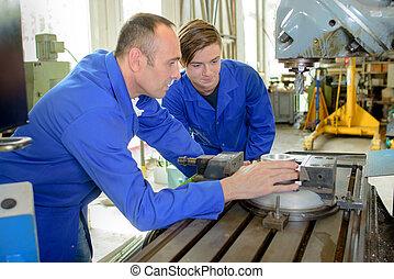 metal worker with apprentice