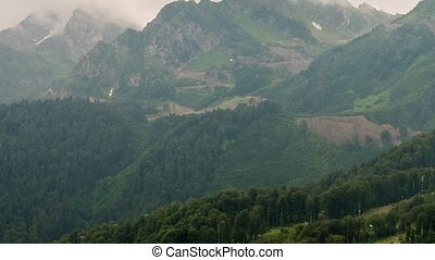 Mountainside in clouds. Spole. Panorama. Time Lapse. Sochi,...