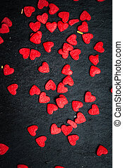 Beautiful valentines day background with red hearts on black...